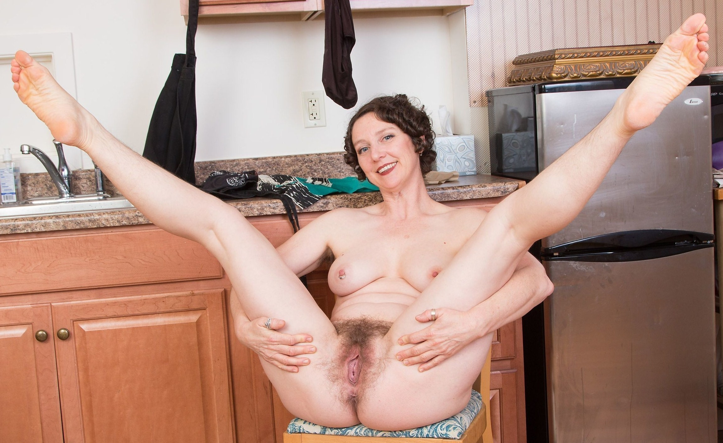 Teen hairy pussy older housewife torments her hairy pussy with kitchen utensils
