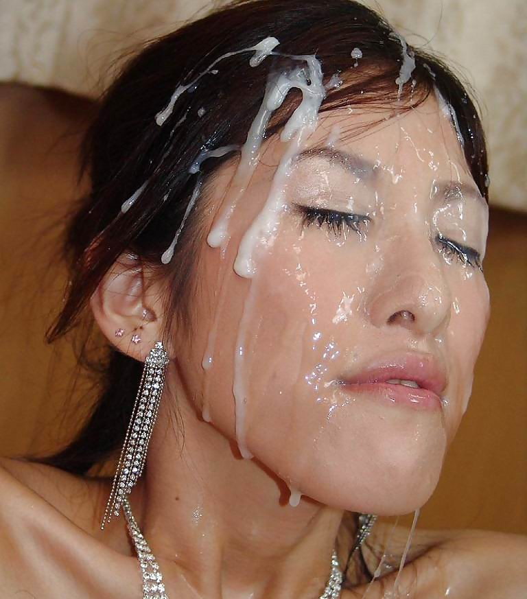 Asian gets covered in cum — photo 11